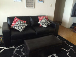 Beautiful Black Leather couch and ottoman!!