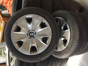 """16"""" eagle ultra winter tires on steel rims with BMW hubcaps"""