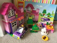 Lego house with car and figure