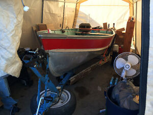 14 foot Lund, trailer and 15 horse evinrude