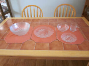 Four piece glass dinner  ware for sale.