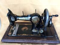 Sewing machine Jones Family. Wooden cover.