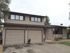 PRICE REDUCED! Spacious home backing green space in Kipling, SK!