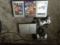 PS2 silver slimline plus leads, controllers and 3 games
