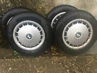 Winter tyres 175/70 R14 84Q M+S on hubs with BMW hubcaps