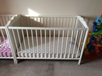 IKEA white cot and mothercare protective mattress