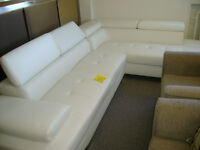 New funky white leather sectional. $1499.