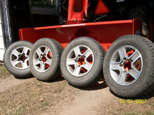 4 All Season Motomaster Tires with Tracker MAGS