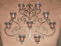 Cast iron wall mounted candle holder