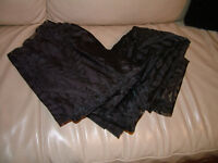 2 Black coloured window curtains