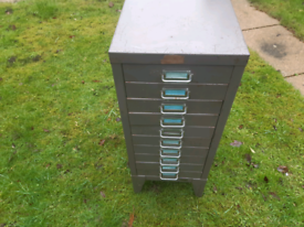 Very small metal cabinet