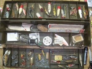 old metal tackle box full of vintage fishing lures and contents