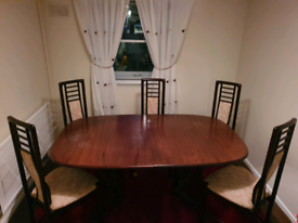 Solid wooden table dining room table.