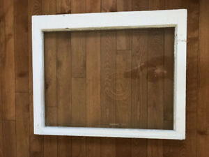 Antique decorative window frame with glass