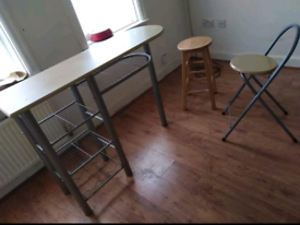 table with storage and one fold up chair