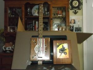 Cigar Box ukulele and cigar box amp