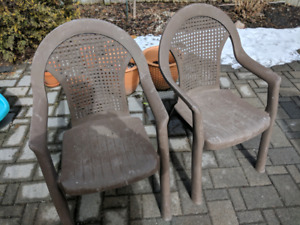 2 patio chairs and red table