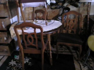 apartment size round table and a double drop leaf table
