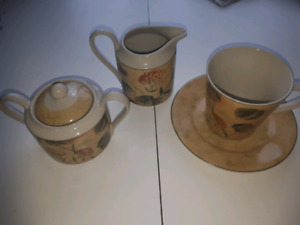 """Asian Antique"" Cups (7) , saucers (8) , cream and sugar dishes"
