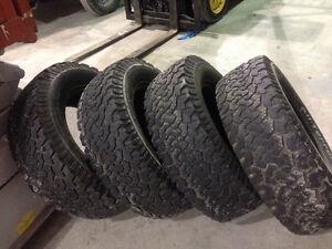 4 truck tires LT275 65R 18 400 firm.