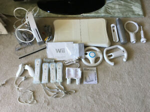 Wii console, accessories, 13 games for sale