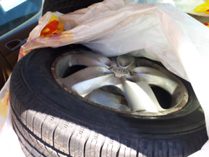 Brand new 4 season tires with used rims