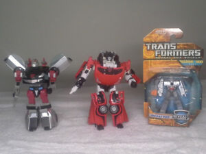 Classic Silverstreak, Sideswipe, and Megatron transformers
