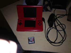 Red Nintendo DS for sale with charger and game!