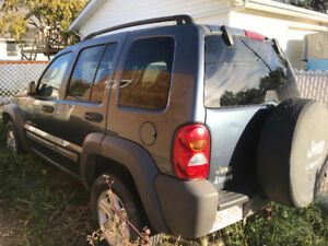 Two 2002 Jeep Liberty SUV, Crossover