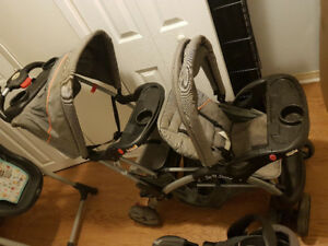 Double stroller with carseat . Highchair. Playpen