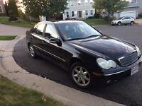 Black Mercedes Benz C240