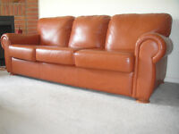 CLASSIC 100% BUFFALO LEATHER COUCH AND OTTOMAN paid 3500