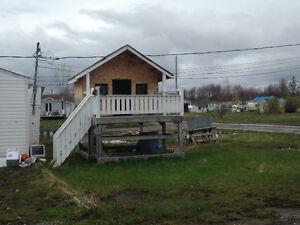 Cabanons et petite maison en bois