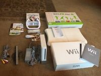 Nintendo Wii games console with Wii fit plus board and