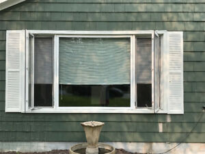 Window insert, 122×69 inches with two casement windows