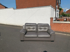 3 seater sofa in grey leather £75 few marks hence price