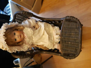 Rare Porcelain doll, with baby carriage.