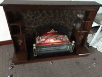 Electric fire with beautiful mahogany wood surround