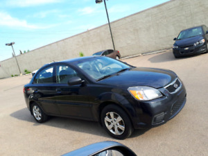 Kia rio 2011   Runs excellent . Very good/gas.