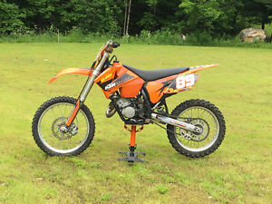 VERY NICE KTM 125SX IN GREAT CONDITION & BIKE CARRIER