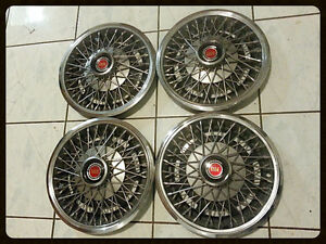Lincoln Mark VII spoked wheel covers