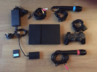 PlayStation 2 with Singstar, 1x Controller and 13x Games