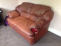 Free and available immediately, brown leather sofa!
