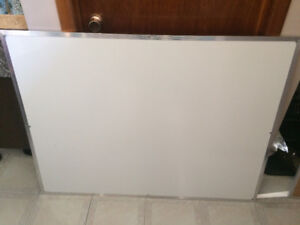 Two white boards and a cork bulletin board