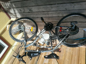 i got 2 80cc gas mountain bikes only ridden twice sell 450 4both