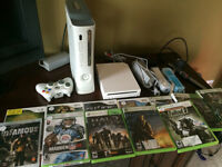 One used XBOX360, One used WII, and 12 games ( Wii and XBox360)