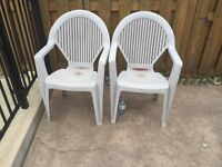 2 Strong Plastic Patio - Outdoor Chairs $10 for 2