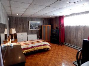 Grande chambre à louée dans une maison