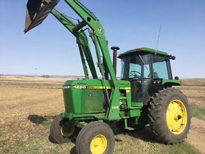 J.D. 4250  LOADER  TRACTOR and  Sprayer