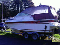 Doral 24 ft. boat with trailer trade for equipment tractor etc.